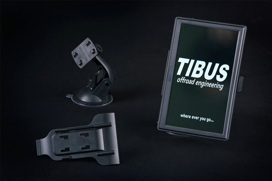"The display of the ""TMS18"" is equipped with a standard bracket which fits to most smartphone holders, though we also supply a suction holder to fix the display at the dashboard or wind screen."